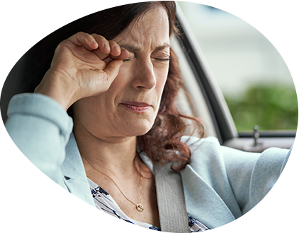 Close up of a woman rubbing her eyes to show that her chronic dry eye is bothering her.