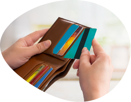 Close-up of a woman's hand zippering her wallet.